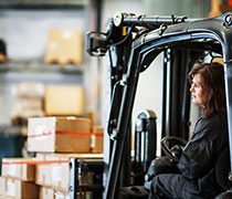 Woman driving a forklift truck.