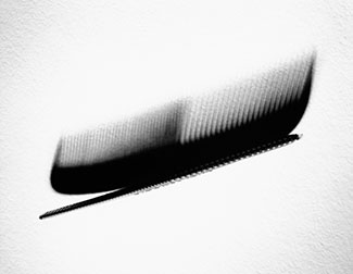 Comb and its shadow, close-up.