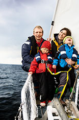 Family on sailing boat.