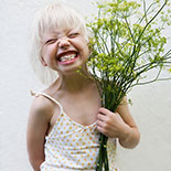 Girl holding fennel bouquet.