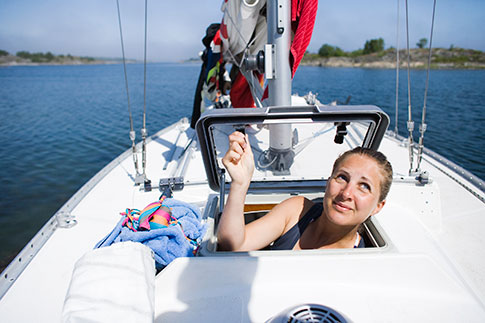 Woman on sailing boat.