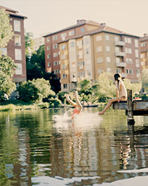 Couple swimming in central lake.