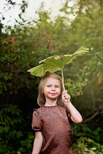 Girl with a huge leaf.